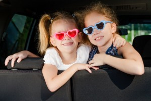 two little girls  sitting in the car